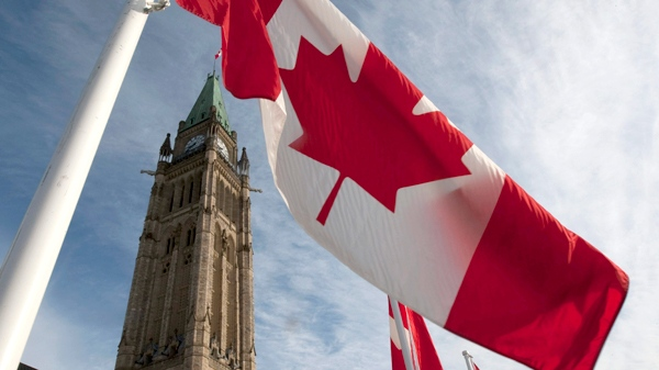 A Canadian flag flies under the Peace Tower, ahead of the resumption of Parliament in Ottawa, on Wednesday, March 3, 2010. (Adrian Wyld / THE CANADIAN PRESS)