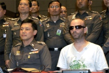 Christopher Paul Neil is seen at a police news conference in Bangkok, Thailand on Friday, Oct. 19, 2007. (AP / Apichart Weerawong)