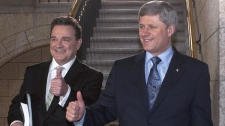 Finance Minister Jim Flaherty (left) and Prime Minister Stephen Harper signal thumbs up in the foyer of the House of Commons prior to Flaherty delivering the budget on Parliament Hill in Ottawa on Thursday, March 4, 2010. (Pawel Dwulit  / THE CANADIAN PRESS)