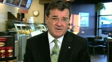 Finance Minister Jim Flaherty appears on CTV's Canada AM from a coffee shop in London, Ont., Friday, March 5, 2010.