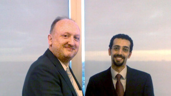 In this file photo, Danish daily newspaper Politiken editor Toeger Seidenfaden, left, shakes hands with Saudi Arabian Lawyer Faisal Yamani during their meeting in London on Thursday Feb. 25, 2010. The Politiken newspaper said Friday Feb. 26, 2010, that it had handed over an official apology from the newspaper for reprinting cartoon images of the Prophet Muhammad with a bomb-shaped turban, in their newspaper.(AP PHOTO/POLFOTO, PER MAGID)