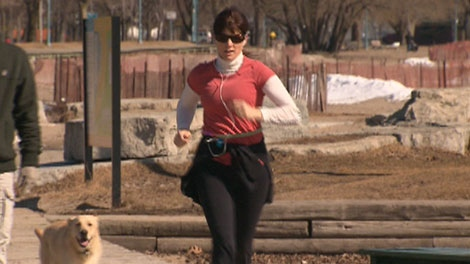 A Toronto woman takes advantage of the bright sunshine to exercise outdoors on March 5, 2010.