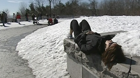 A woman enjoys the warm sun in Montreal.