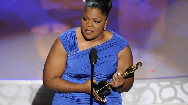 Mo'Nique accepts the Oscar for best performance by an actress in a supporting role for 'Precious: Based on the Novel Push by Sapphire' at the 82nd Academy Awards Sunday, March 7, 2010, in the Hollywood section of Los Angeles. (AP Photo/Mark J. Terrill)