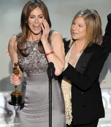 Kathryn Bigelow accepts the Oscar for best achievement in directing for 'The Hurt Locker' from presenter Barbara Streisand at the 82nd Academy Awards, Sunday, March 7, 2010. (AP / Mark J. Terrill)