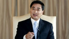 Thailand's Prime Minister Abhisit Vejjajiva gestures during a televised news conference at government house Saturday, Feb. 27, 2010 in Bangkok. Supporters of populist former Thai leader Thaksin Shinawatra denounced a court order to seize US$1.4 billion of his assets, and vowed Saturday to pursue a nonviolent struggle for what they said would be a people's democracy. (AP Photo/Apichart Weerawong)