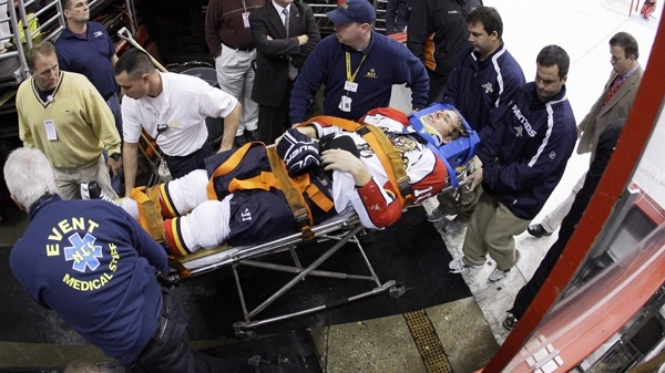 Florida Panthers forward David Booth is wheeled off the ice after being injured in the second period of an NHL hockey game against the Philadelphia Flyers, Saturday, Oct. 24, 2009. Booth suffered a concussion after a blindside head shot. (AP / Matt Slocum)