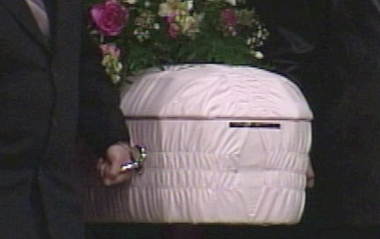 A tiny pink coffin is carried into the Sacred Heart Church of the First Peoples on Tuesday, March, 9th, 2010.