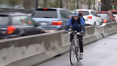 A cyclist pedals over the Dunsmuir Viaduct bike lane on March 10, 2010. (CTV)