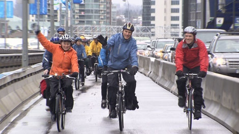 Vancouver Mayor Gregor Robertson opens the Dunsmuir Viaduct bike lane on March 10, 2010. (CTV)