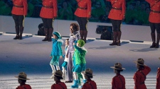Governor General Michaelle Jean is flanked by members of the RCMP during the opening ceremonies of the Winter Paralympic Games in Vancouver, Friday, March 12, 2010. (CP/Jonathan Hayward)