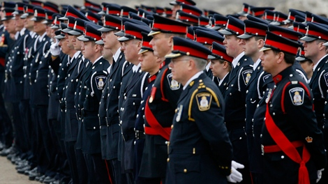 Thousands of law enforcement officers gather for the funeral of Ontario Provincial Police Officer Vu Pham in Wingham, Ont., on Friday, March 12, 2010. (Dave Chidley / THE CANADIAN PRESS)