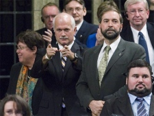NDP Leader Jack Layton points at the Liberal side of the House of Commons as he and his caucus vote against the Harper Conservative government's Throne Speech Thursday, October 24, 2007. (CP / Fred Chartrand)