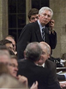 While Liberal Party MPs sit in the foreground and abstain from voting, Bloc Quebecois leader Gilles Duceppe stands to vote against the Conservative government's Throne Speech in the House of Commons in Ottawa Wednesday, October 24, 2007. (CP / Fred Chartrand)