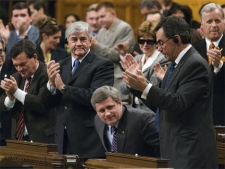 Prime Minister Stephen Harper receives a standing ovation form his colleaques as he stands to vote in the House of Commons, on his governmentsThrone Speech in Ottawa Wednesday, October 24, 2007. (CP / Fred Chartrand)