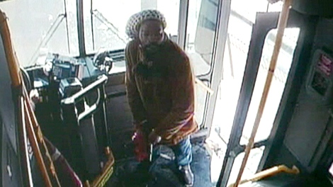 Richard Haynes is shown pulling out a .45-calibre handgun on an Oakwood Avenue TTC bus on Feb. 23, 2009.