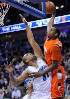 Kris Joseph dunks on a guy.