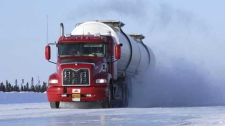 A truck moves down a northern ice road.