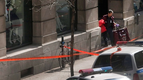 A paramedic leaves the shooting scene at a clothing store in Old Montreal, Thursday, March 18, 2010. (Ryan Remiorz / THE CANADIAN PRESS)