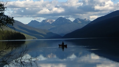 A lone paddler on Isaac lake in Bowron Lake provincial park. (BC Parks)