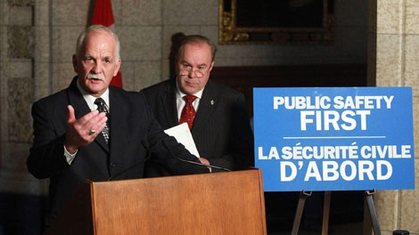 The Honourable Vic Toews, Minister of Public Safety (left), is shown with Daniel Petit, Parliamentary Secretary to the Minister of Justice, after reintroducing the Keeping Canadians Safe (International Transfer of Offenders Act), Thursday, March 18, 2010, in the foyer of the House of Commons in Ottawa. (MARKETWIRE PHOTO /Public Safety Canada)