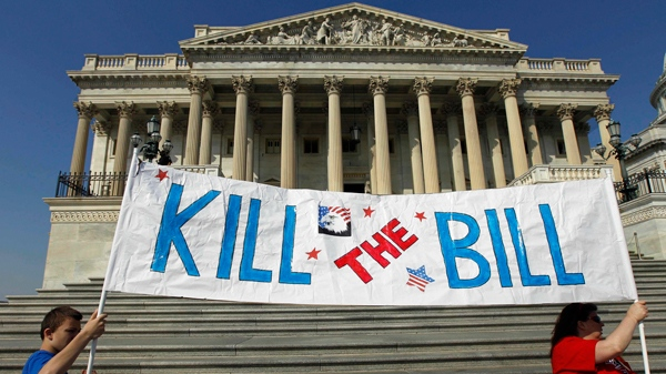Protesters gather on the East Front of the U.S. Capitol in front of the House of Representative, before the House prepares to vote on healthcare ,on Sunday, March 21, 2010.(AP / Alex Brandon)