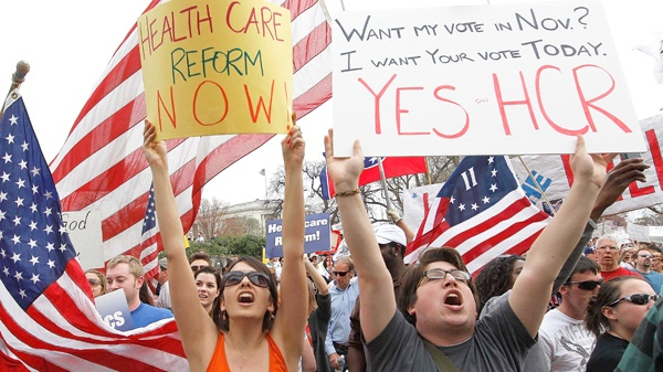 Demonstrators in favor of the health care reform bill chant outside of the U.S. Capitol as the House prepares to vote on the bill in Washington, Sunday, March 21, 2010. (AP / Charles Dharapak)