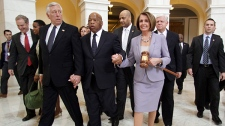 House Speaker Nancy Pelosi, D-Calif., holds a large gavel as she walks through the Cannon Rotunda after a Democratic Caucus, along with from left, are Reps. Steny Hoyer, D-Md., John Lewis, D-Ga., and John Larson, D-Conn. on Capitol Hill in Washington, Sunday, March 21, 2010. (AP / Lauren Victoria Burke)