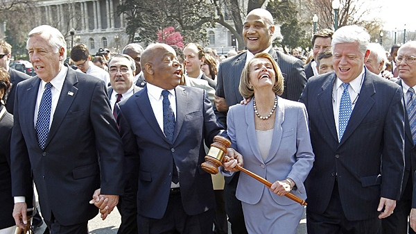 Speaker Nancy Pelosi of California holding the gavel used to pass Medicare Reform, laughs as she walks across the street and into the U.S. Capitol as the House prepares to vote on health care reform in the U.S. Capitol in Washington, Sunday, March 21, 2010. (AP / Charles Dharapak)