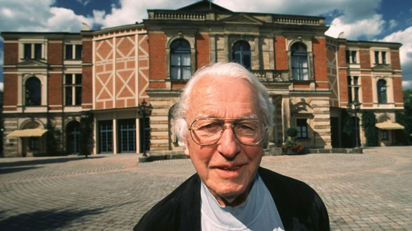 Wolfgang Wagner, a descendant of composer Richard Wagner, stands in front of the Festspielhaus theater in Bayreuth, Germany, in this July 21, 1998 file photo. (AP / Frank Boxler)
