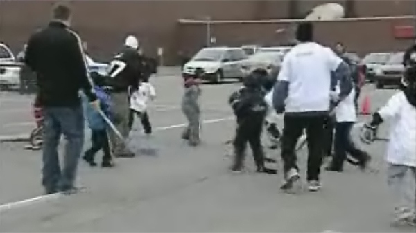 Children and adults play street hockey outside the Dollard-Des-Ormeaux Civic Centre as a form of protest on Monday, March 22, 2010.