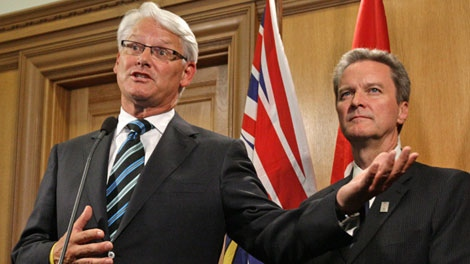 British Columbia Premier Gordon Campbell, left, and Finance Minister Colin Hansen speak to reporters after Hansen tabled the provincial budget at the B.C. Legislature in Victoria, B.C., on Tuesday September 1, 2009. (CP/Darryl Dyck)