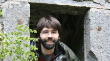 Joe Hill's website photo. The caption says: 'He lives in a small stone cell at the bottom of a chasm; there is only one steep, treacherous trail leading down to it, and the way is protected by fierce goats.'