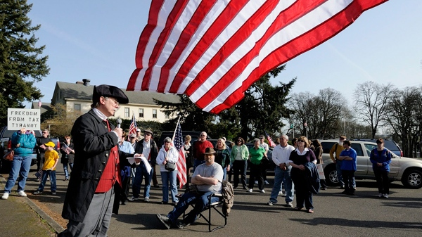 Tom Niewulis of Battle Ground, Wash. is dressed as Samuel Adams, one of the United States' founding fathers, to deliver a speech in protest of the health care reform bill to approximately 40 protesters in Vancouver, Wash. on Tuesday, March 23, 2010. (AP / The Columbian, Troy Wayrynen)