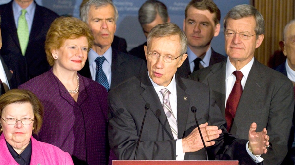 Senate Majority Leader Harry Reid of Nev., center, speaks during a health care reform news conference on Capitol Hill in Washington, Thursday, March 25, 2010. (AP / Harry Hamburg)