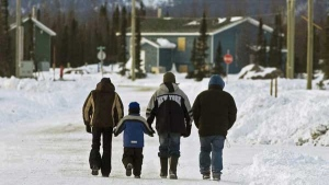 Residents walk in the northern Labrador community of Natuashish, N.L. on Thursday, Dec. 6, 2007. (Andrew Vaughan /  THE CANADIAN PRESS)