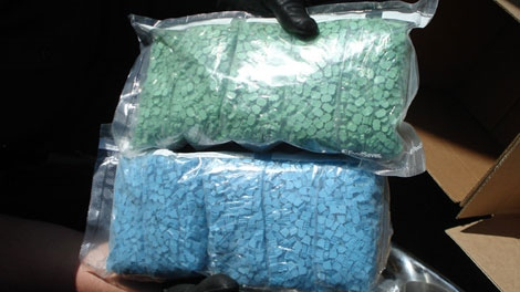 Police show off samples from approximately 60 pounds of ecstasy seized from a North Vancouver woman's car. July 1, 2010. (CTV)