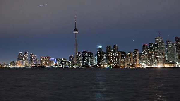 The darkened Toronto skyline is seen from Toronto Island at 8:30pm during the official start of Earth Hour on Saturday March 27, 2010. (Cole Burston / THE CANADIAN PRESS