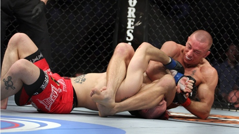 UFC Welterweight Champion Georges St. Pierre, right, attempts an armbar against Dan Hardy during their match at the Prudential Center in Newark, NJ on Saturday, March 27, 2010.