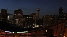 Downtown buildings go mostly dark to celebrate Earth Hour but lights stay on at the Saddledome, foreground, because of an event in Calgary, Alberta on Saturday March 27, 2010. (Larry MacDougal / THE CANADIAN PRESS)