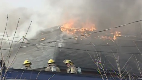 Flames tear through the roof of an apartment building in the Glebe, Saturday, March 27, 2010.