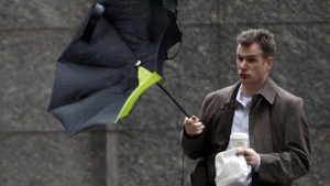 Wind upsets a person's umbrella during a storm in Philadelphia, Tuesday, March 30, 2010. (AP / Matt Rourke)