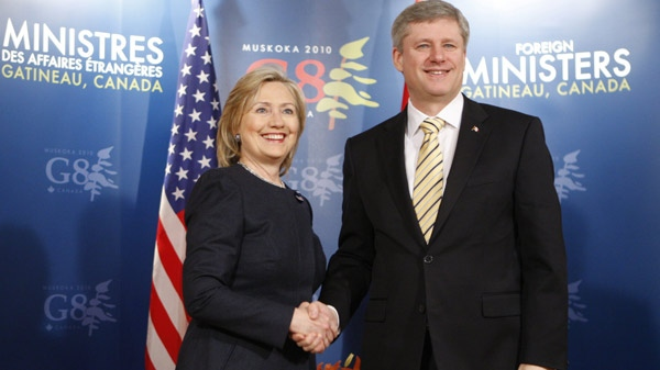 Prime Minister Stephen Harper shakes hands with U.S. Secretary of State Hillary Clinton before a bi-lateral meeting at the G8 Foreign Ministers meeting in Gatineau, Que., Tuesday, March 30, 2010. (Adrian Wyld / THE CANADIAN PRESS)