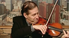 Roger Frisch, who played his violin during brain surgery, demonstrates his abilito play on Canada AM from Minneapolis, Tuesday, March 30, 2010.