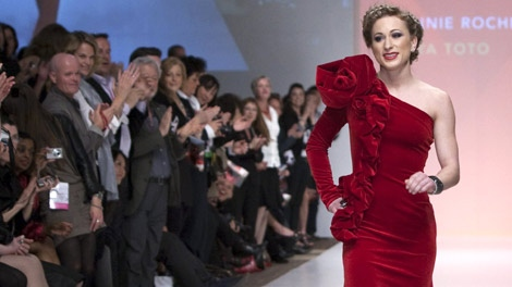Joannie Rochette receives a standing ovation as she walks the runway in 'The Heart Truth' show, part of Fashion Week in Toronto on Wednesday, March 31, 2010. (Frank Gunn / THE CANADIAN PRESS)