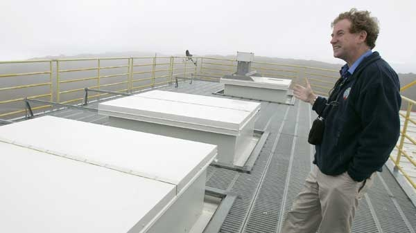 James Drummond, a Dalhousie University professor and chief investigator for the Canadian Network for the Detection of Atmospheric Change, stands, July 24, 2006 on the roof of the Polar Environment Atmospheric Research Laboratory (PEARL), on Ellesmere Island in the Canadian territory of Nunavut. (AP / Ted S. Warren)