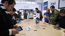 Apple customers try out of the new Apple iPad on its first day of release at an Apple store in San Francisco, Saturday, April 3, 2010. (AP / Paul Sakuma)