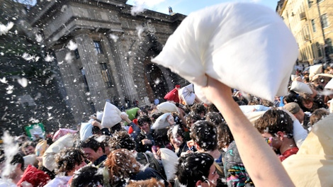 Dozens of people take part in a great pillow fight at the Zamkowy square in Warsaw, Poland, Saturday, April 3, 2010. The event was a part of the so called International Pillow Fight Day.(AP Photo/Czarek Sokolowski)