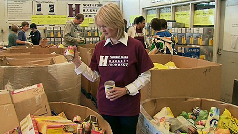 A volunteer at the North York Harvest Food Bank sorts donations at the organizations headquarters on Lawrence Avenue West on April 4, 2010.