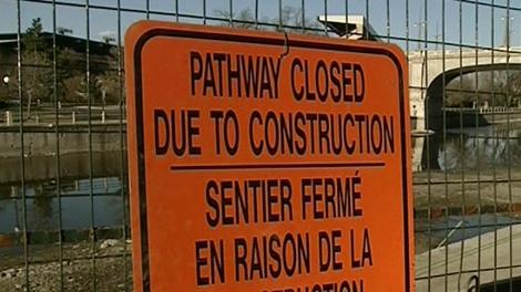 Repair work has closed part of a pathway along the Rideau Canal and Colonel By Drive.